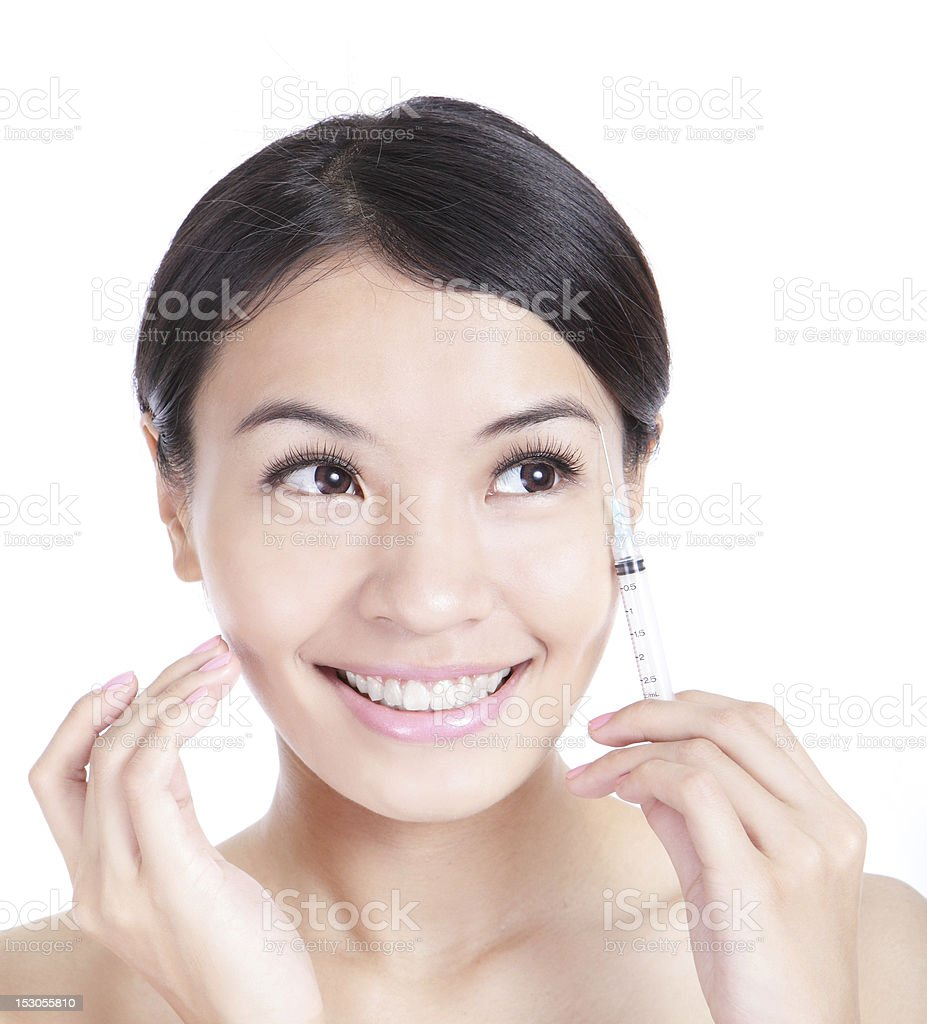 Cosmetic injection to the pretty woman face royalty-free stock photo