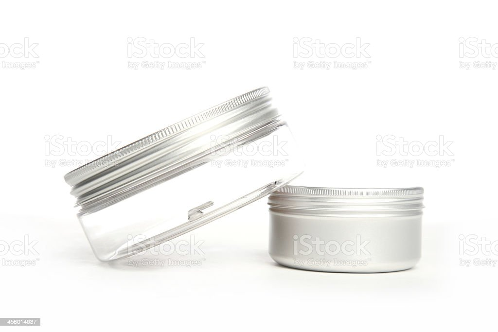 Cosmetic jar on top of can royalty-free stock photo