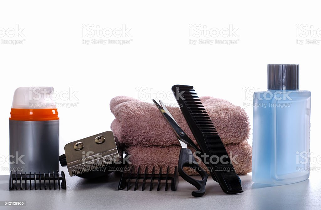 cosmetic kit and hair clipper on a white background stock photo
