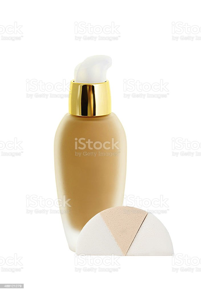 Cosmetic liquid foundation and sponges isolated on white stock photo