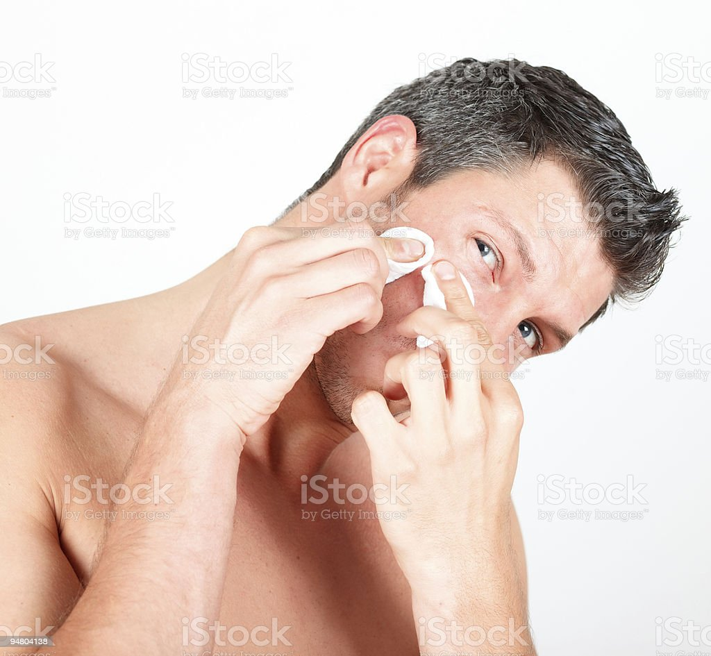 cosmetic man removing pimple royalty-free stock photo