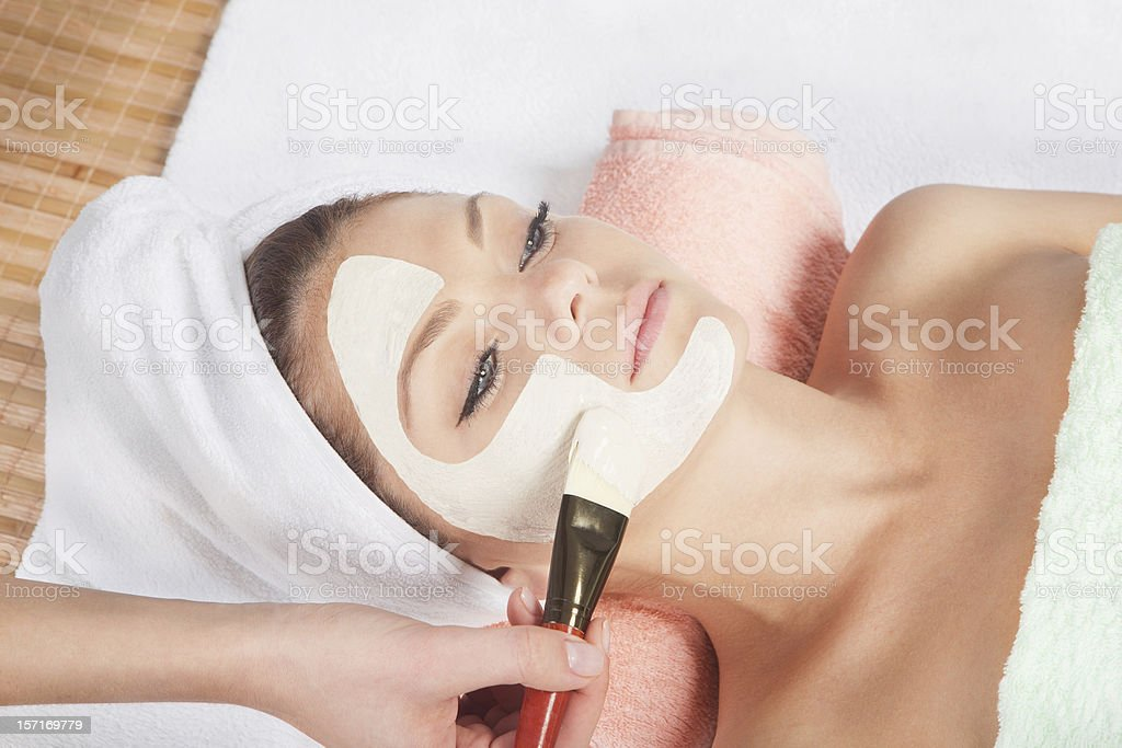 cosmetic mask at spa salon stock photo