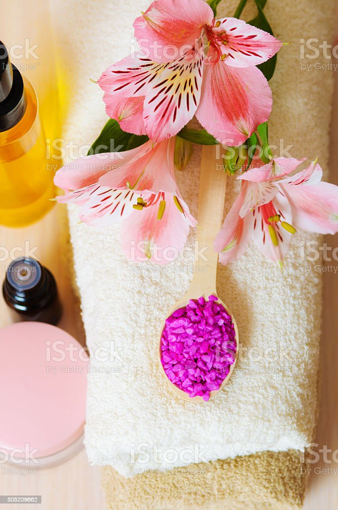 Cosmetic moisturizing cream towels and flowers stock photo