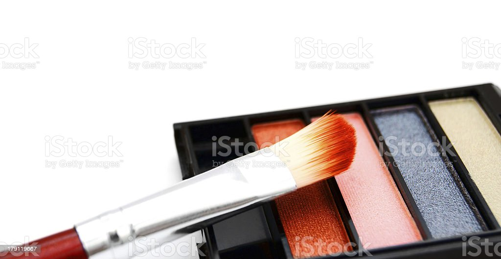 Cosmetic powder and brush. On a white background. royalty-free stock photo