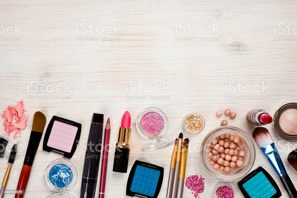 Cosmetic products on wooden background with copy space at top stock photo