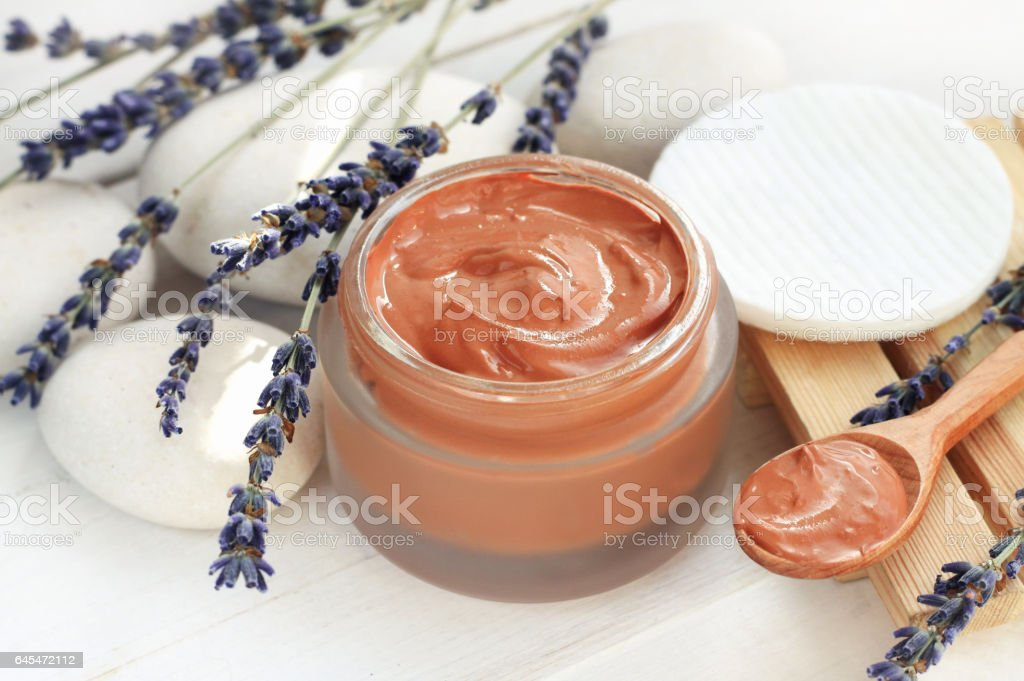 Cosmetic red clay mask stock photo