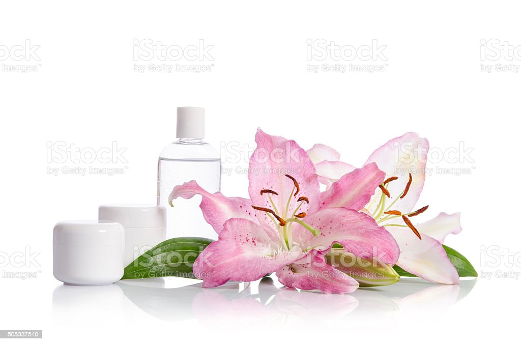 cosmetic set for skin care with flowers lilies stock photo