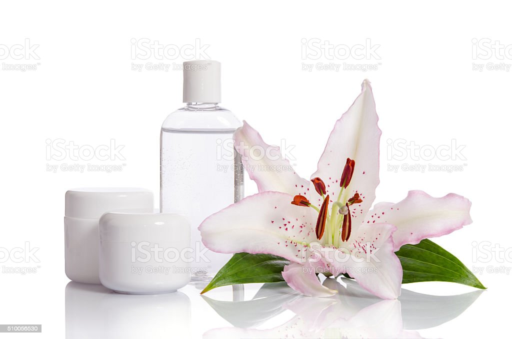 cosmetic set for skin care with lily flower stock photo