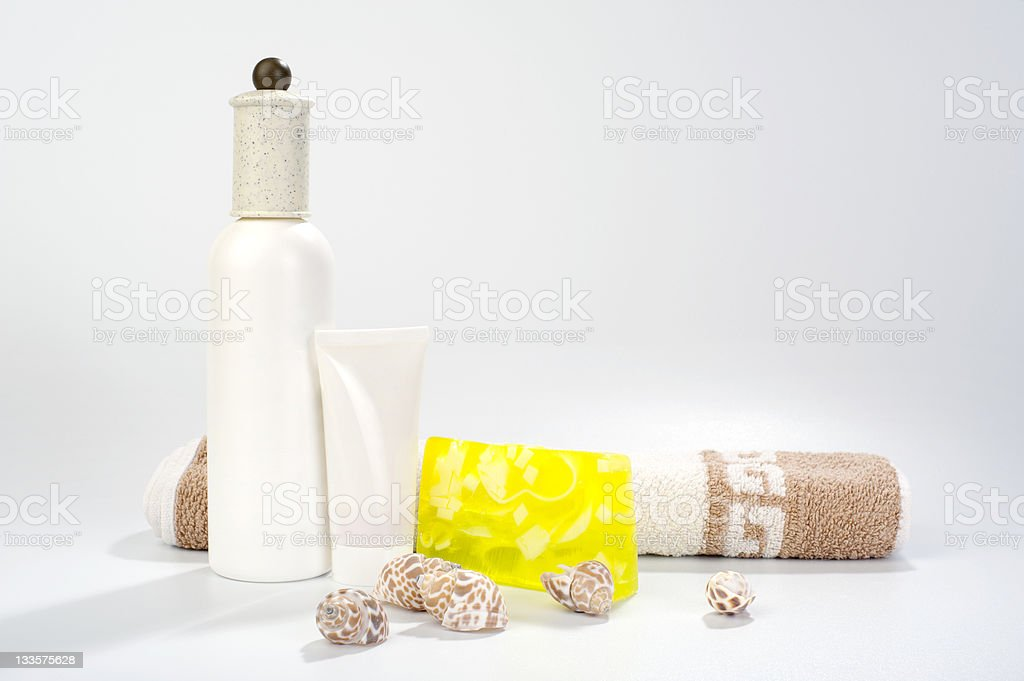 cosmetic set with hand-made ​​soap, towel and shells royalty-free stock photo