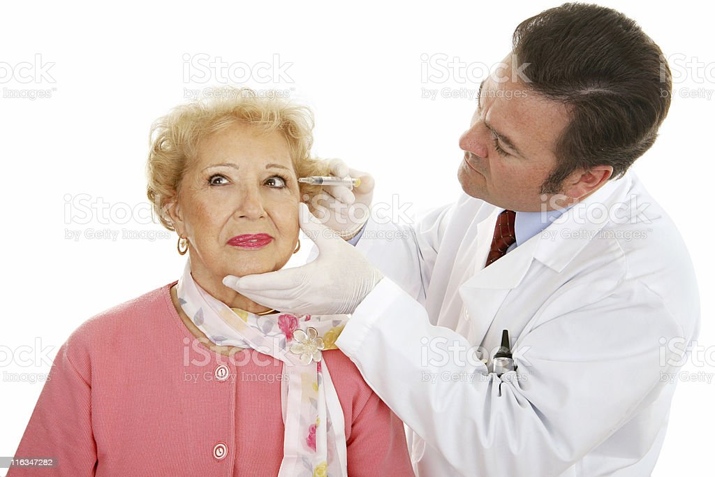 Cosmetic Surgeon at Work royalty-free stock photo
