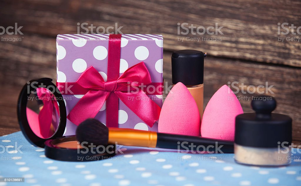 Cosmetics and gift box on woodent table. stock photo