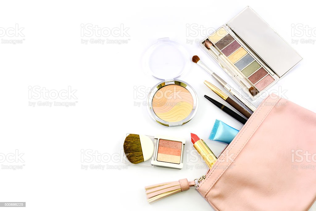Cosmetics, brushes and a pink pouch stock photo