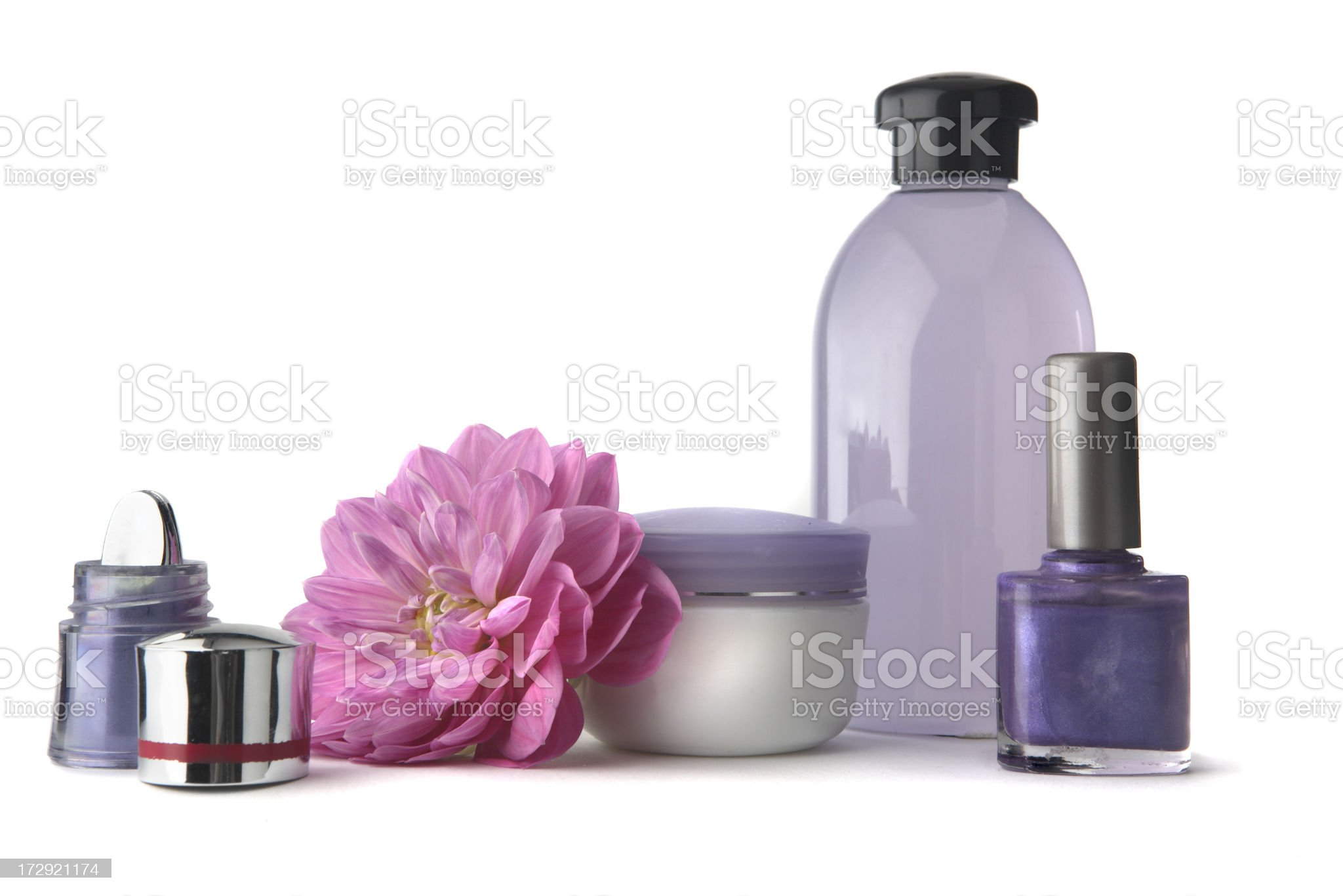 Cosmetics: Eyeshadow, Nail Polish, Soap, Moisturizer and Flower royalty-free stock photo