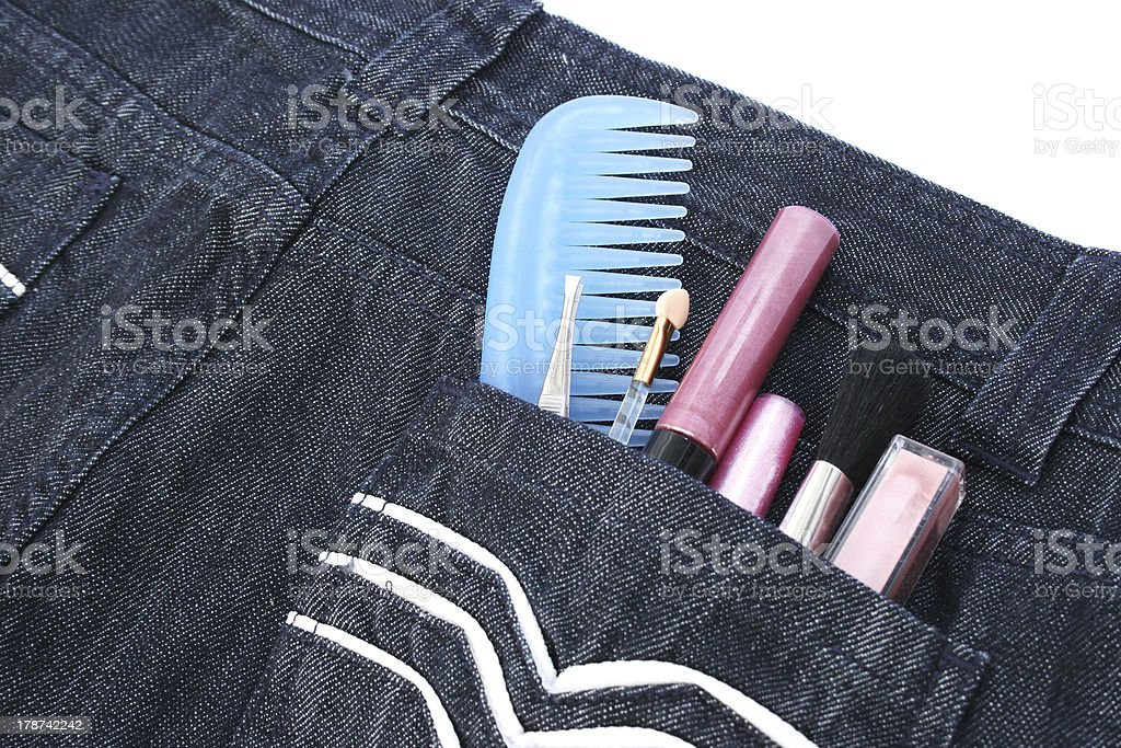 Cosmetics in jeans pocket royalty-free stock photo