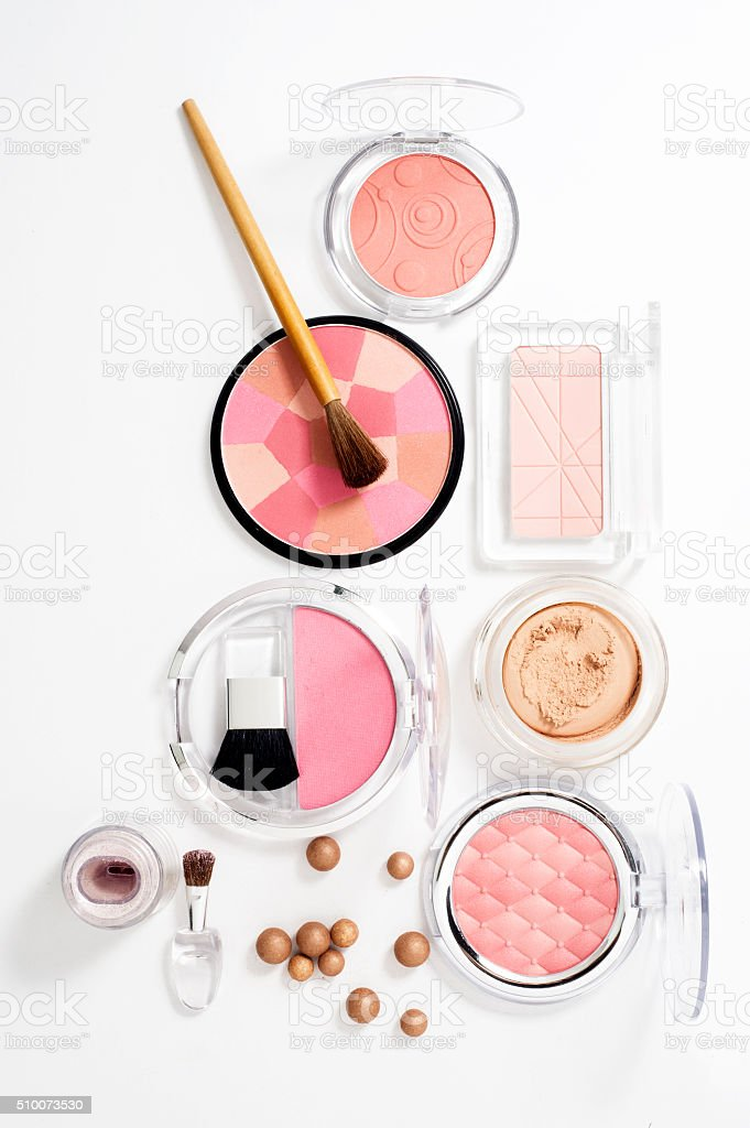cosmetics on white background with light shadows stock photo