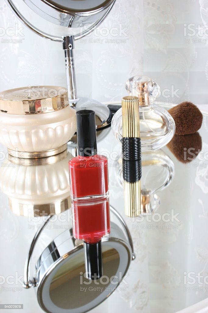 Cosmetics reflected in a mirror royalty-free stock photo