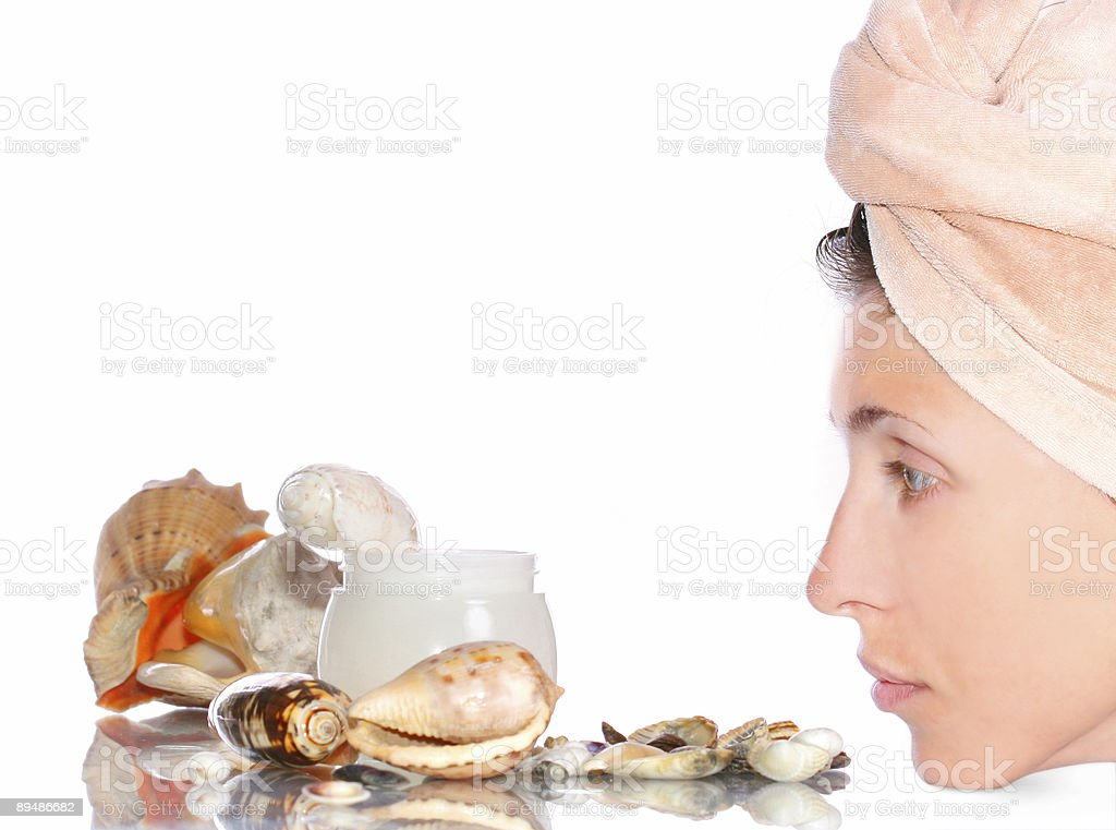 Cosmetics sea cream and woman's face royalty-free stock photo