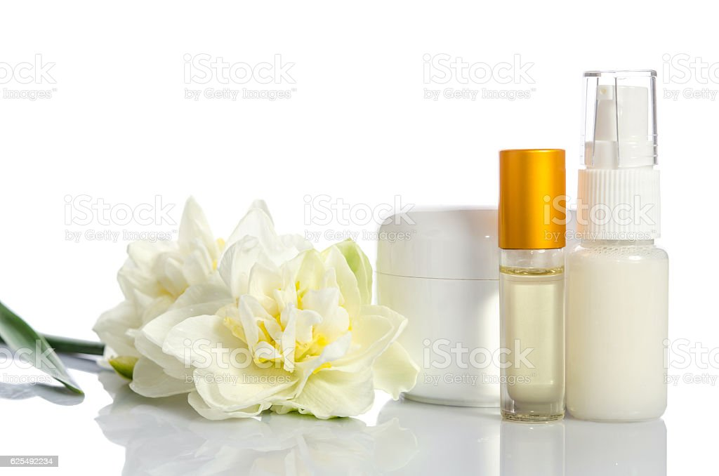 cosmetics with flowers isolated  on white background stock photo