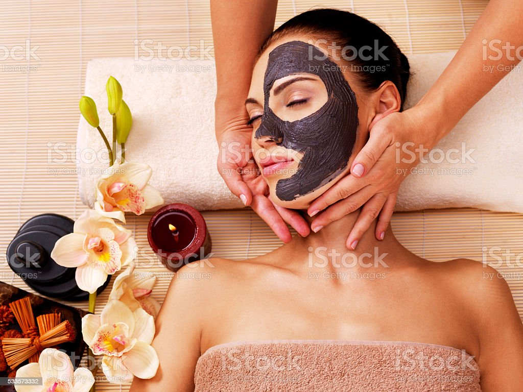Cosmetologist doing massage on the woman's face  in sap stock photo