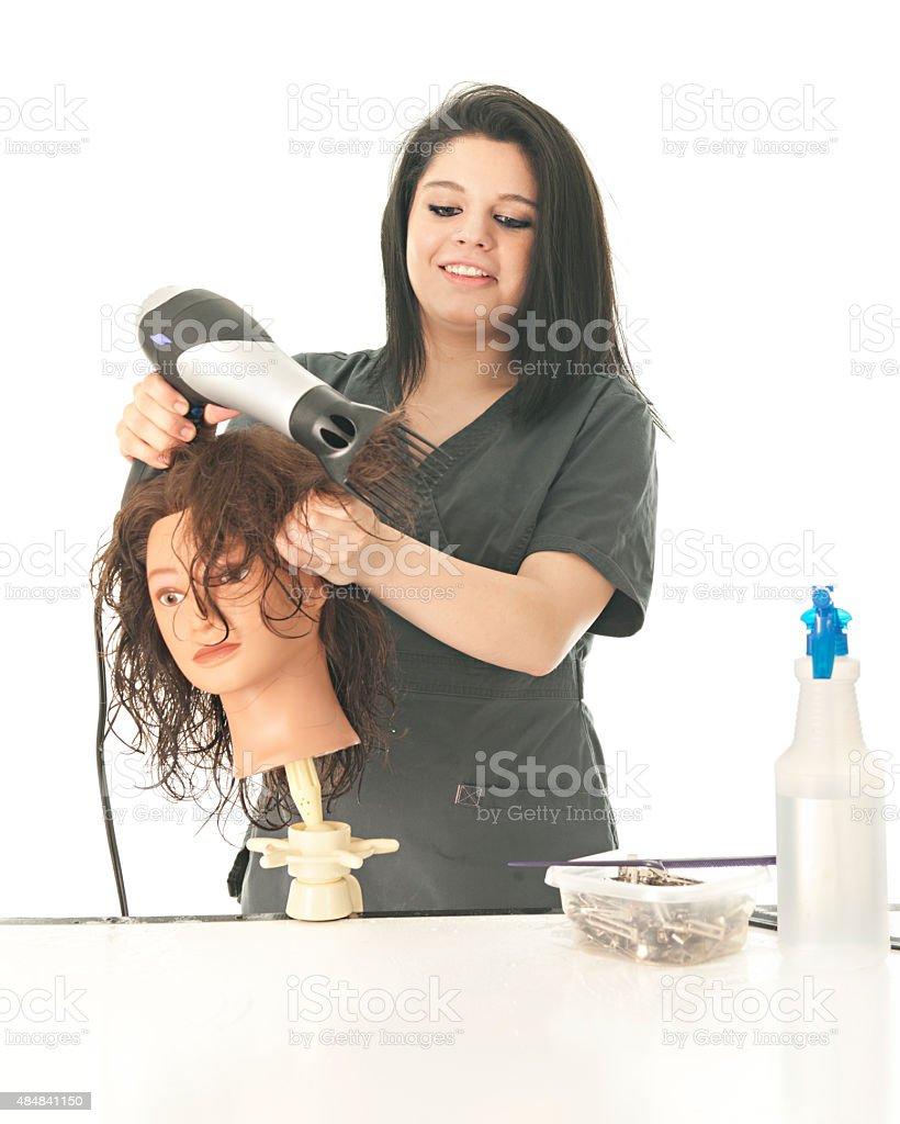 Cosmetology Student Enjoying Her Class stock photo