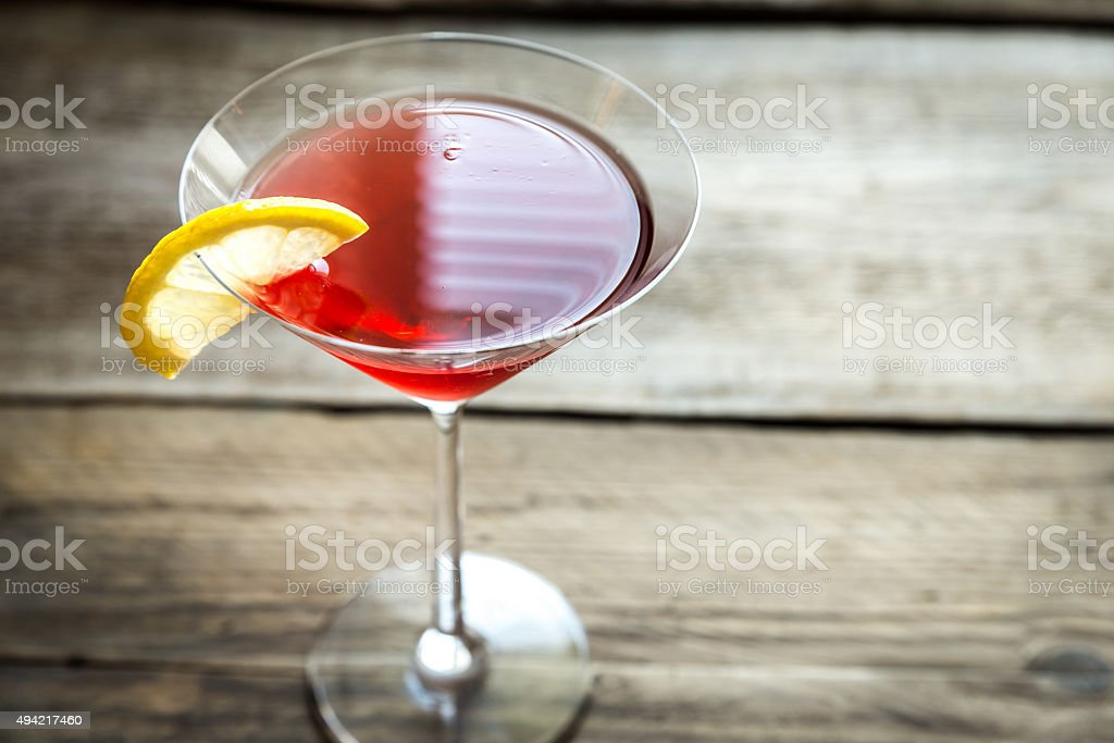 Cosmopolitan cocktail on the wooden background stock photo