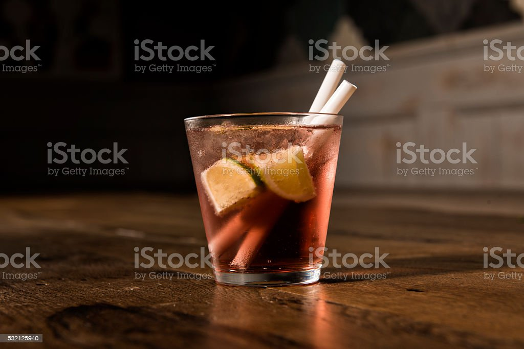 cosmopolitan cocktail with limes stock photo