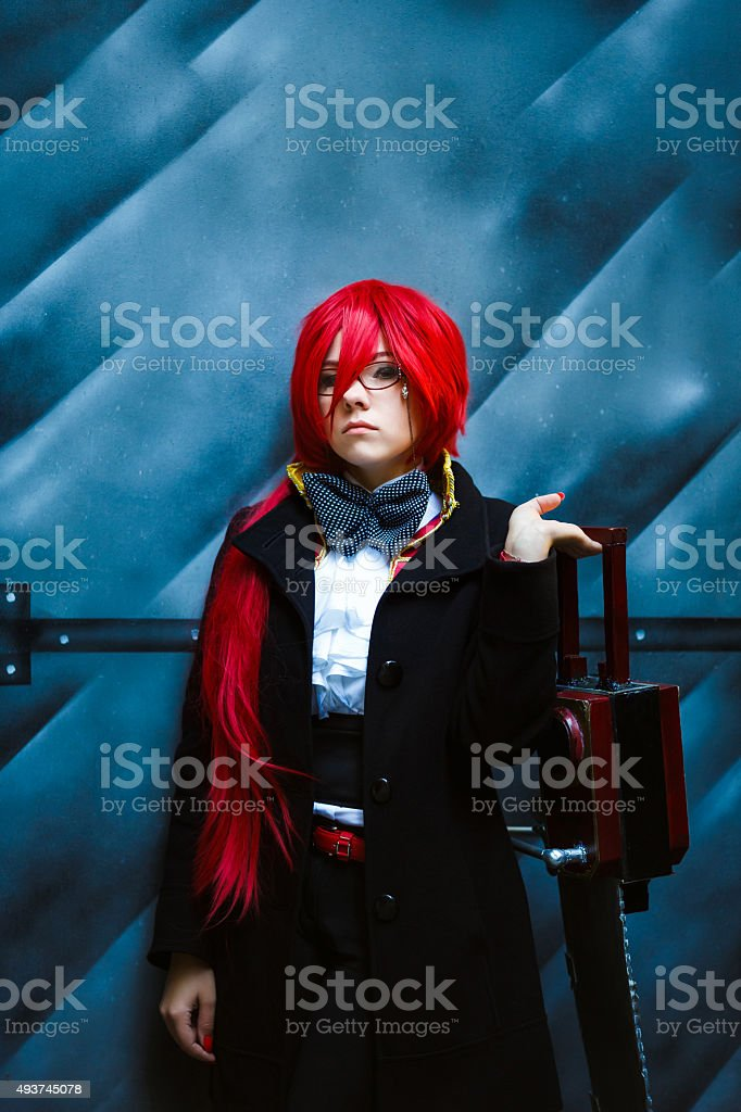 Cosplay girl with chainsaw stock photo