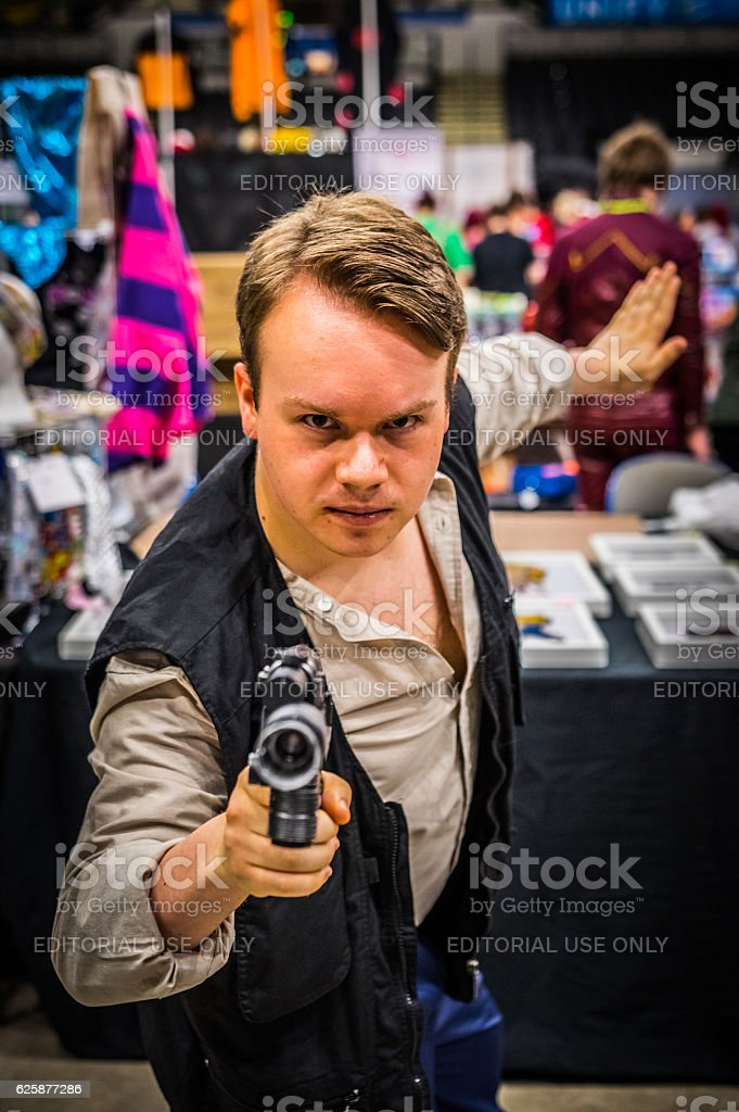 Cosplayer dressed as 'Han Solo' from 'Star Wars' stock photo