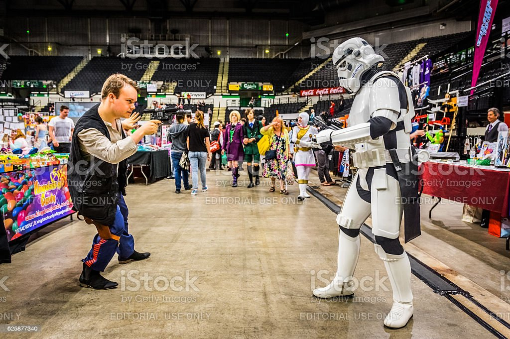 Cosplayers dressed as a 'stormtrooper' and 'Han Solo' stock photo