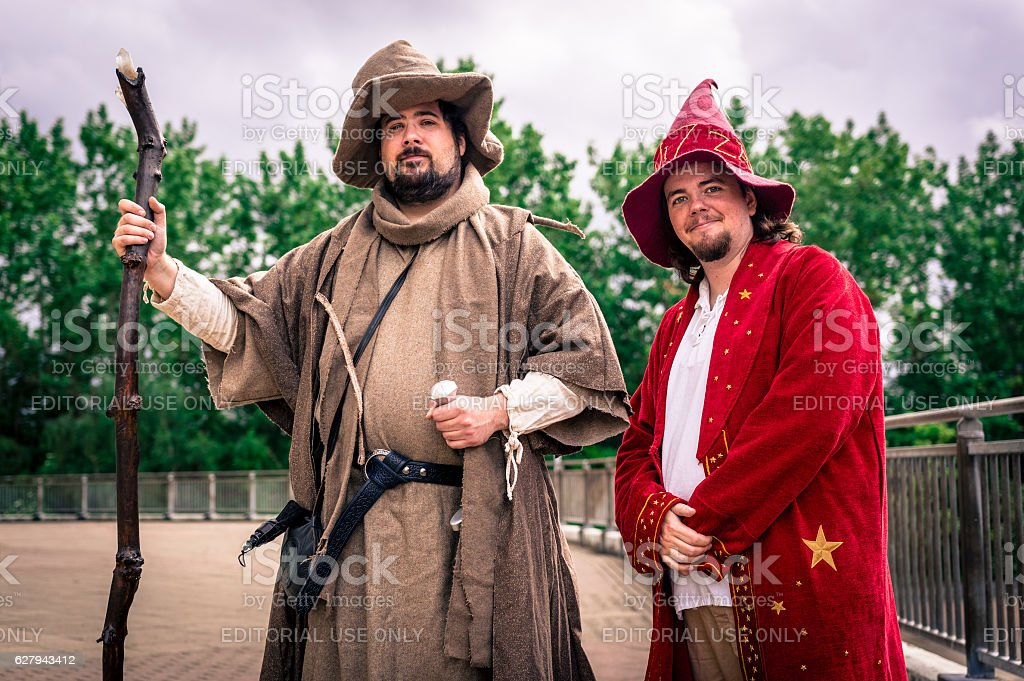 Cosplayers dressed as wizards stock photo