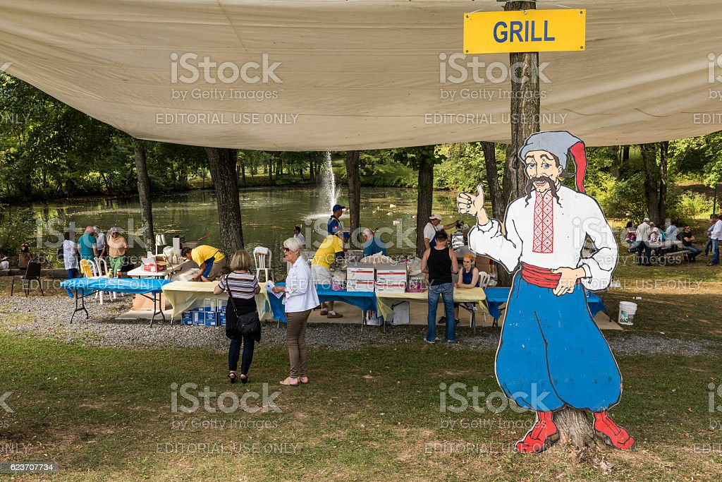Cossack man with grill sign at Ukrainian festival stock photo