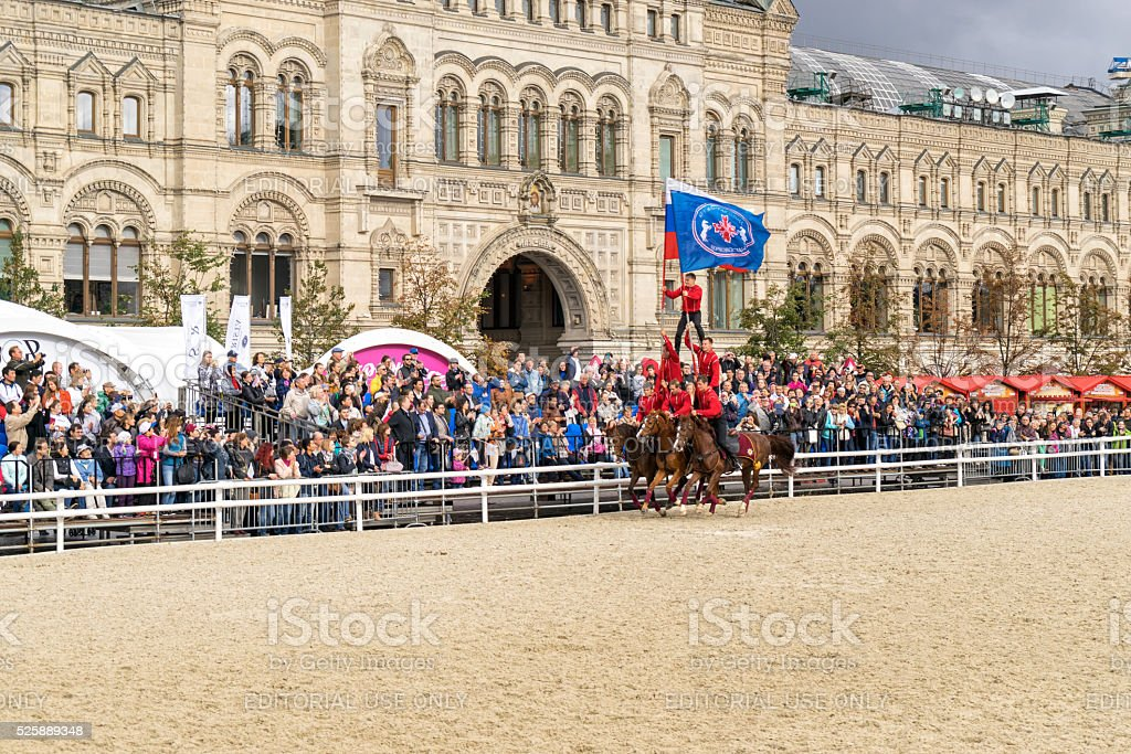 Cossacks in full-dress uniform demonstrate skill of trick riding stock photo