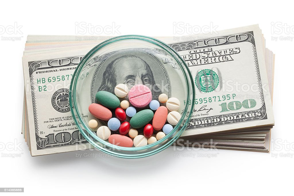 Cost of Healthcare. Pills on US dollars. stock photo