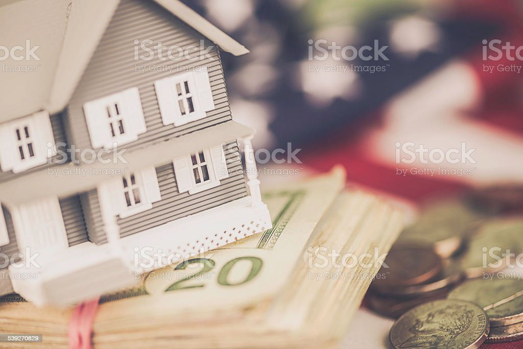 Cost of the American Dream. US Mortgage costs. US currency. stock photo