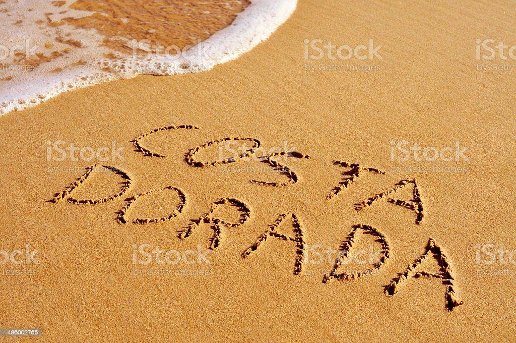 Costa Dorada written in the sand stock photo