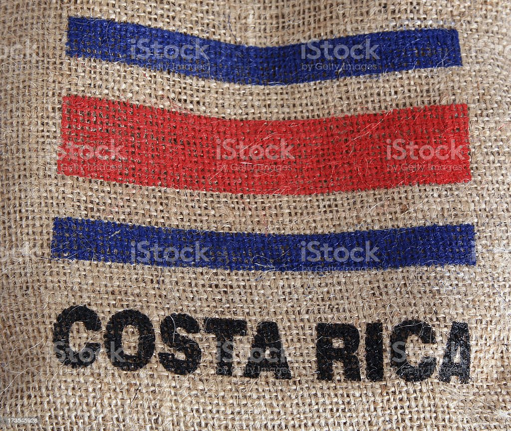 Costa Rica flag on burlap coffee bag stock photo