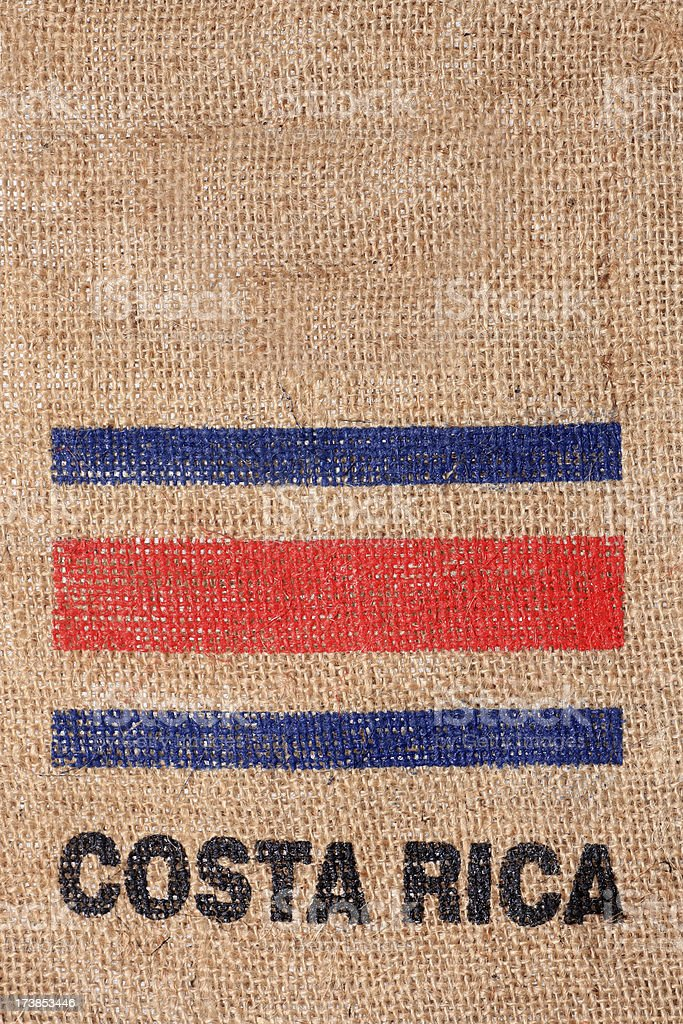 Costa Rica flag on burlap coffee bag stock photo