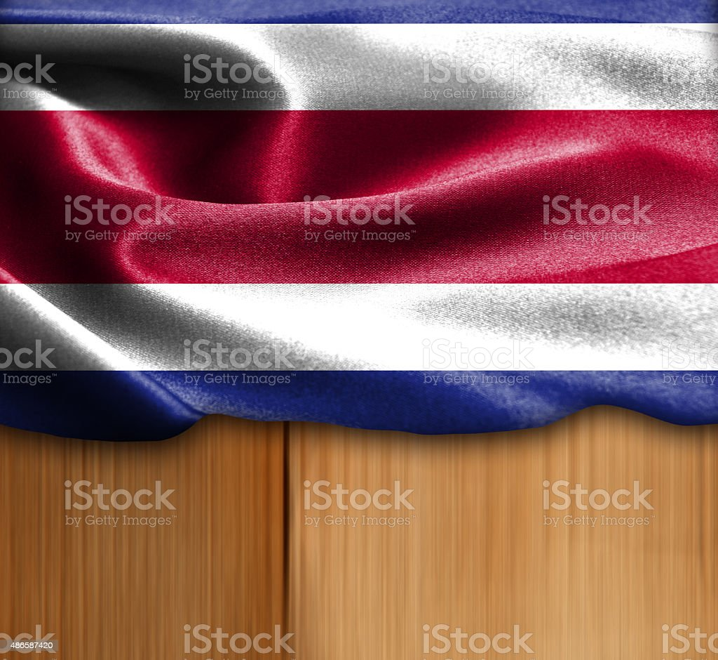 Costa Rica flag on wood Texture stock photo