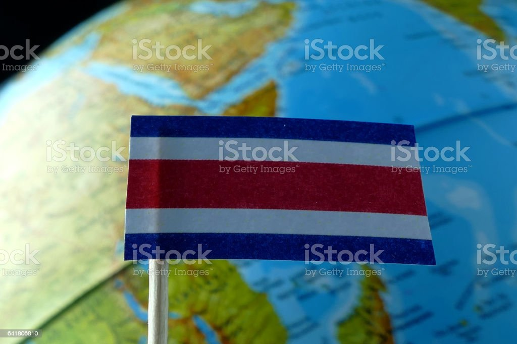 Costa Rica flag with a globe map as a background stock photo