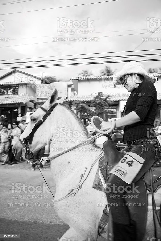 Costa Rican cowgirl in downtown Playas del Coco stock photo