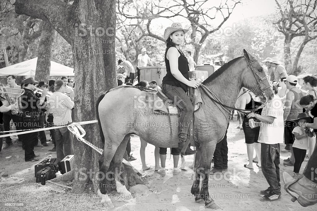 Costa Rican cowgirl on her horse. stock photo