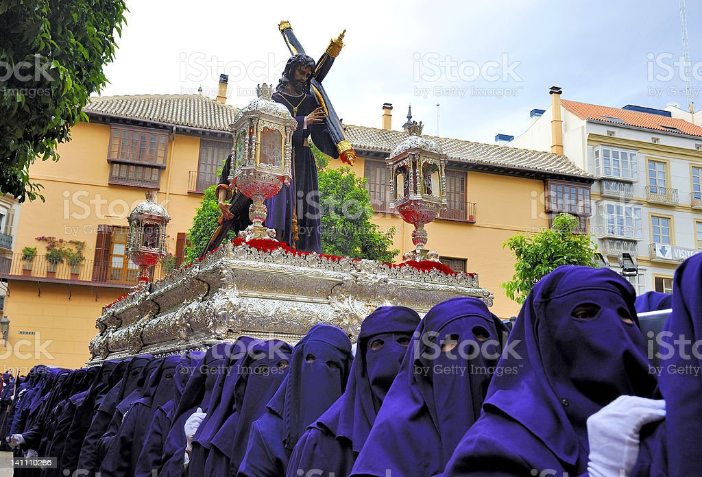 Costaleros bearing a Tronos during Semana Santa in Malaga, Spain stock photo