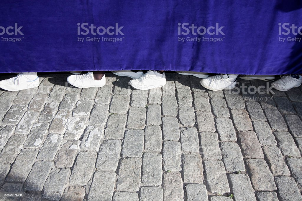 costaleros' feet underneath a parade float in Holy Week , Seville stock photo