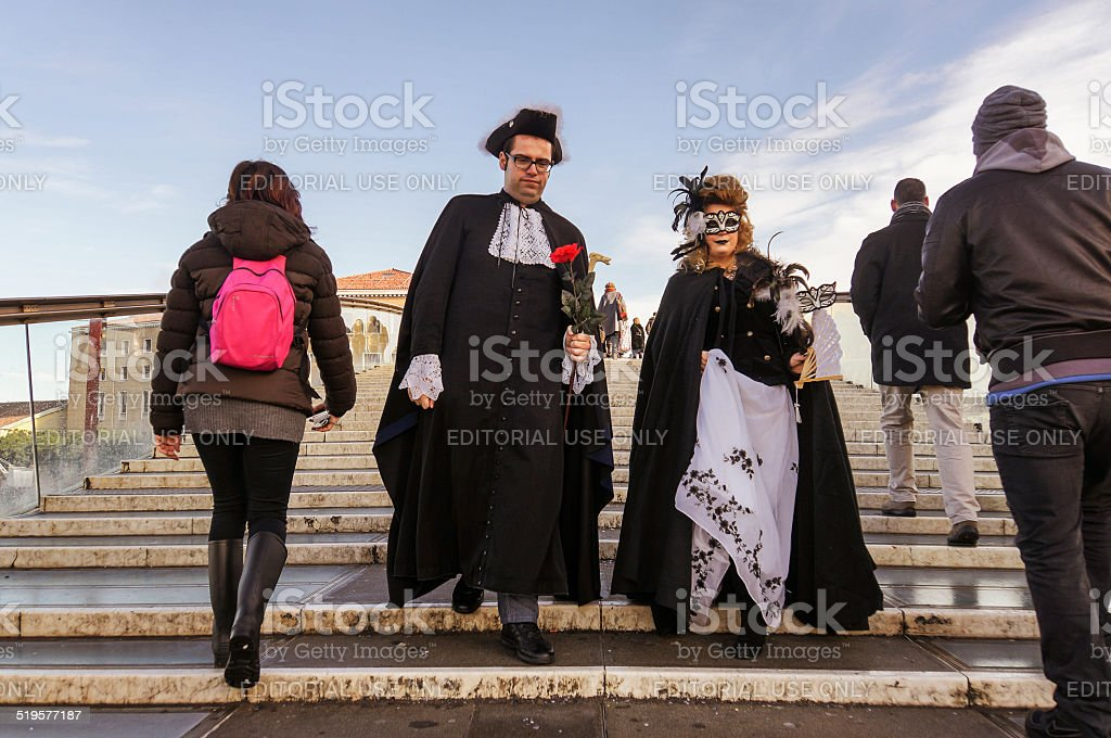Costume couple on stairs stock photo