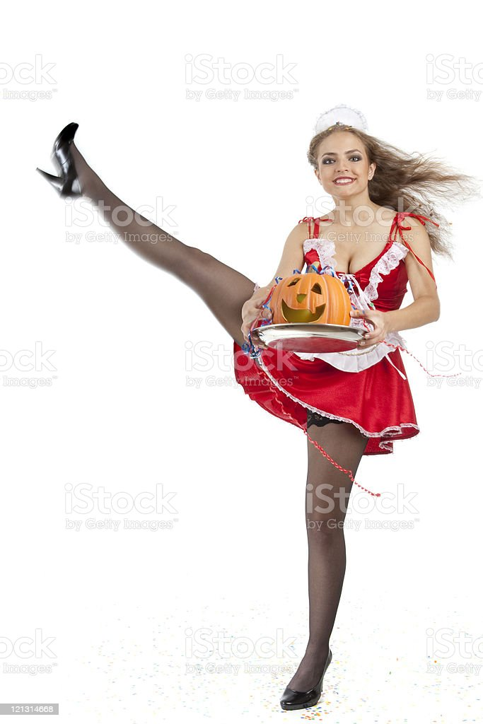 Costume series: sexy maid dancing cancan and holding halloween pumpkin. royalty-free stock photo