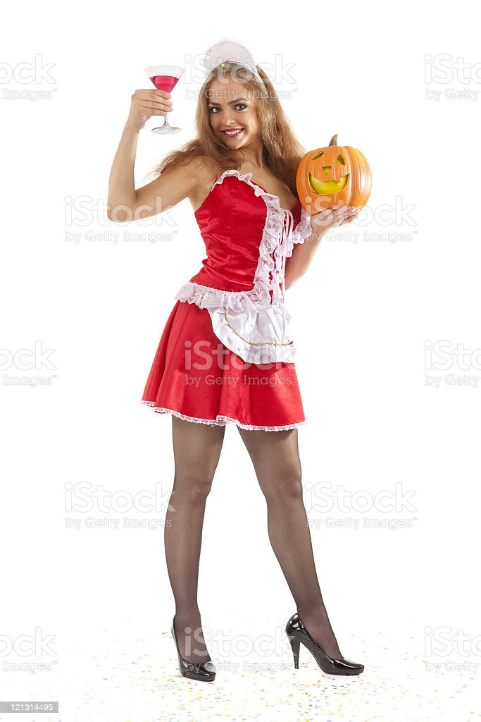 Costume series: sexy maid holding martini glass and pumpkin.  XXXL royalty-free stock photo