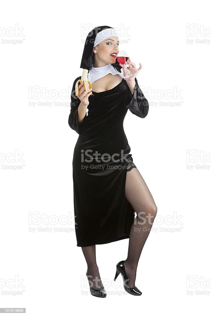 Costume series: sexy nun drinking red wine and eating banana. royalty-free stock photo