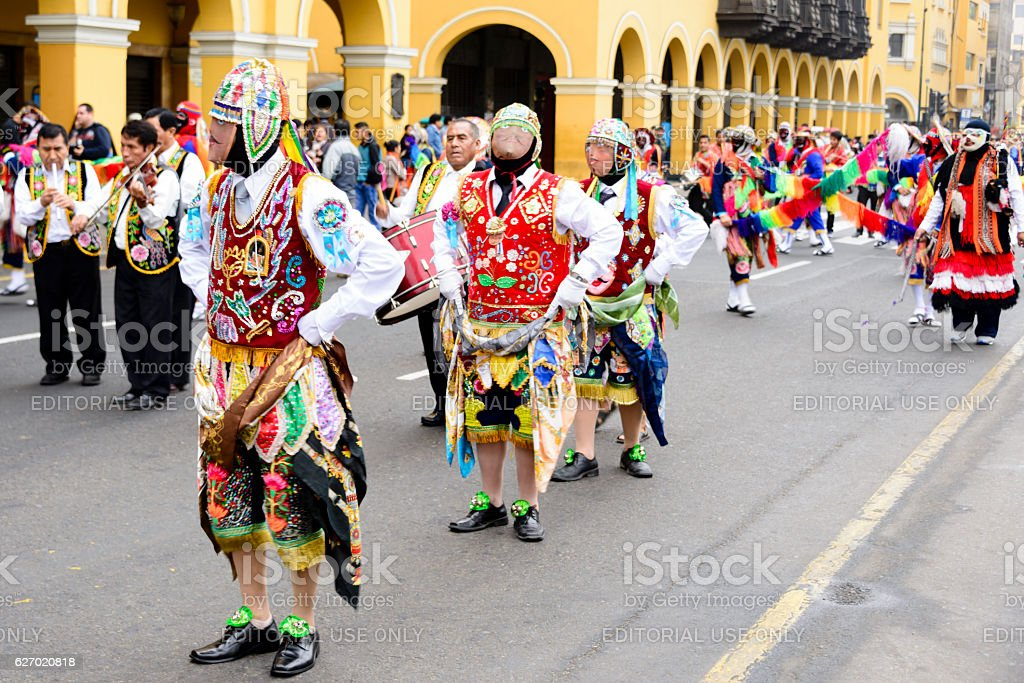 Costumed dancers during a traditional celebration. stock photo