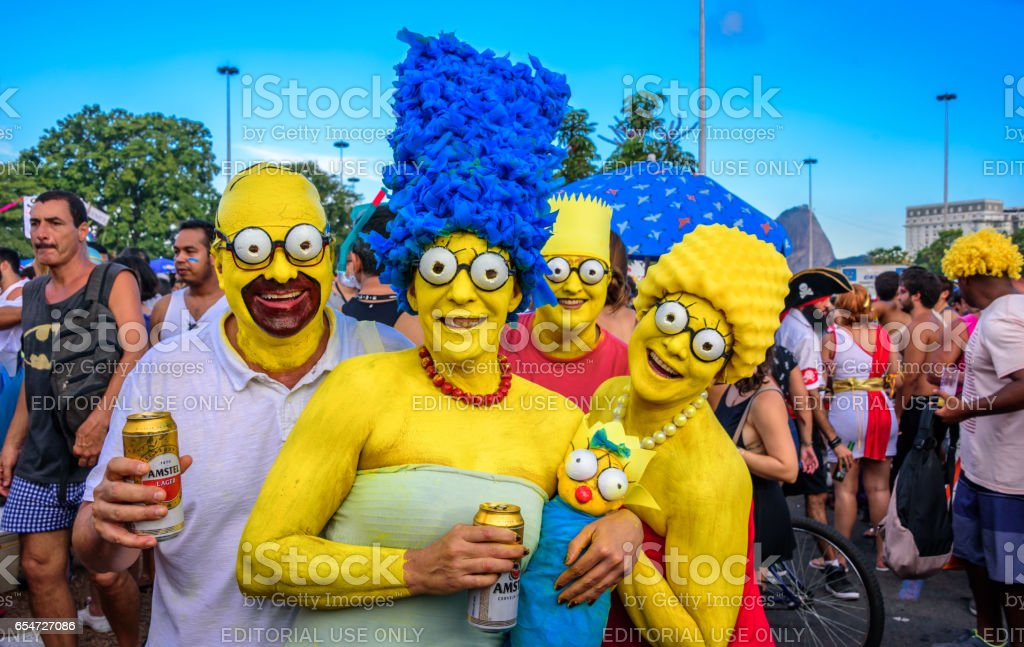 Costumed family of the Simpsons with Homer, Marge, Bart, Lisa and Maggie at Bloco Orquestra Voadora, Carnaval 2017 stock photo
