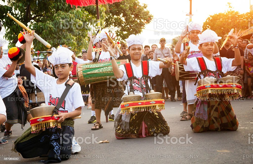 Costumed Indonesian boys performing during Nyepi Ngrupuk parade Bali Indonesia stock photo